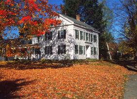White house surrounded by autumn leaves