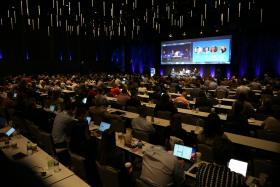 Attendees at the 2019 iOi Summit watching presentations