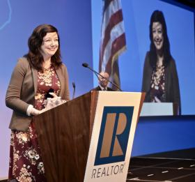 Courtney Wilson National Association of REALTORS® on stage at AEI 2019