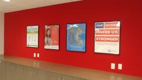 Image of framed program and product posters from NAR.