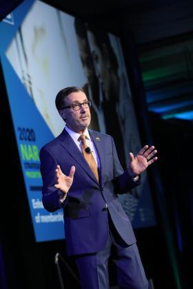 Vince Malta on stage at Leadership Summit