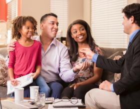 Multi-ethnic family meets with REALTOR®