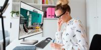 Woman at Large Screen Computer