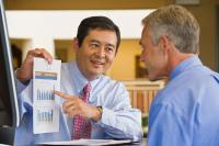 Businessman Showing Chart to Coworker