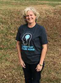 Carla A. Rose, CEO, Salisbury Rowan REALTORS®, N.C., wearing the T-shirt all C2EX participants earn once completing the program.